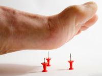 Боль в стопах ног